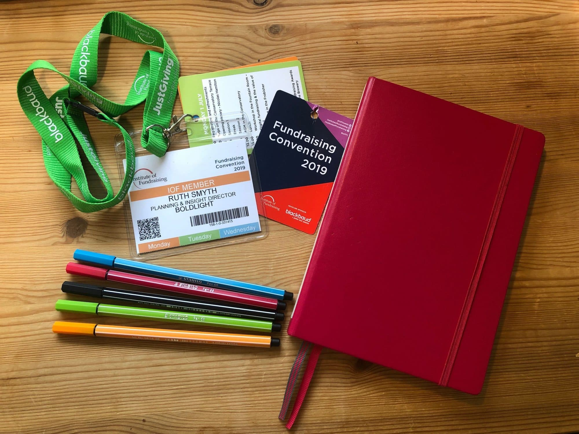 Fundraising convention badge, notebook and pens